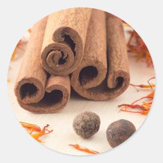 Cinnamon sticks, aromatic saffron and pimento round sticker