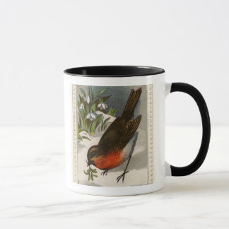 Circa 1871: A robin, with mistletoe in its beak Mug