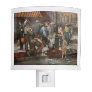 City - NY - Drinking water from a street pump 1910 Night Lites