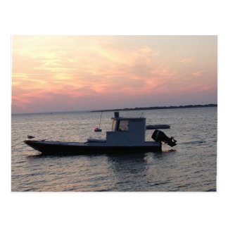 Clam boat on the bay at sunset postcard