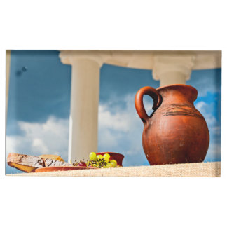 Classic antique still-life with a pitcher table card holders
