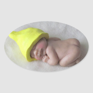 Clay Baby Sleeping on Tummy, Elf Hat, Sculpture Oval Sticker