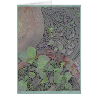 Clay pot and wrought iron in a garden card