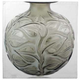 Clear Art Deco glass vase with flower design. Napkin
