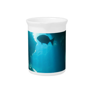 Clear blue cave and fish beverage pitcher