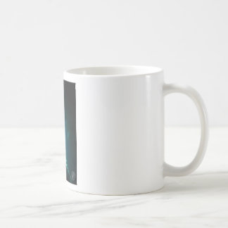 Clear blue cave and fish coffee mug