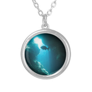 Clear blue cave and fish silver plated necklace