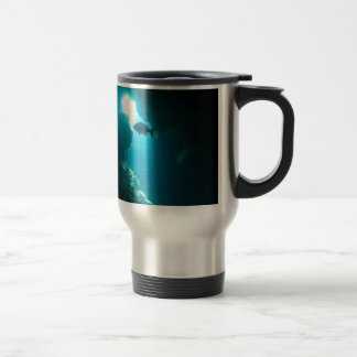 Clear blue cave and fish travel mug