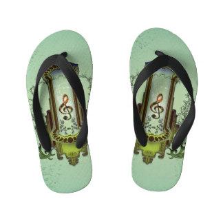 Clef on decorative button kid's flip flops