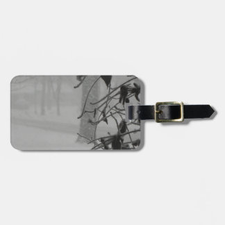Clematis and Snow fall during a blizzard. Luggage Tag