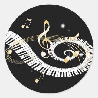 Clés de piano et notes d'or de musique adhésif rond