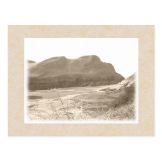 Cliffs in sepia color. On beige background. Postcard