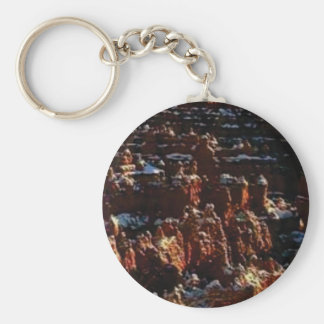 cliffs of the red rock of snow keychain