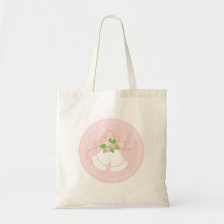 Cloches de mariage en pastel roses sac
