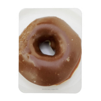Close-up of a chocolate doughnut on a plate rectangular photo magnet