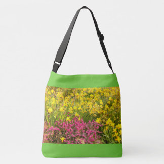 close-up of a coloured flowering on cross body bag