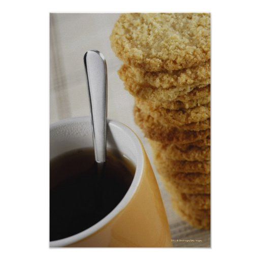 Close-up of a cup of coffee with cookies print