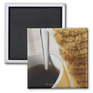 Close-up of a cup of coffee with cookies square magnet