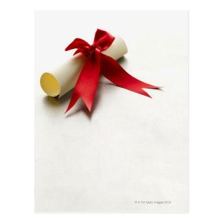 Close-up of a diploma with ribbon postcard