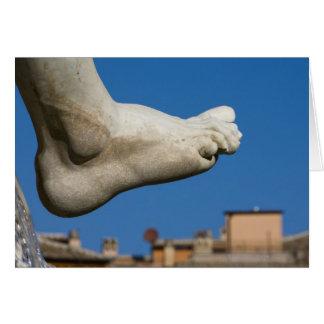 close-up of a foot on the Fontana dei Quatro Card