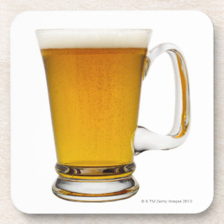 Close up of a glass of beer 2 beverage coasters