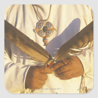'Close-up of a Native American holding Square Sticker