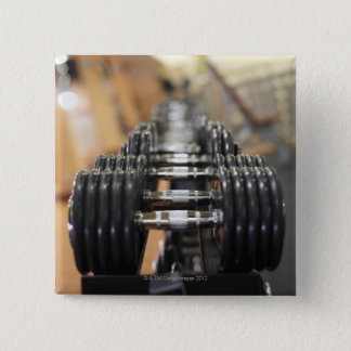 Close-up of a row of dumbbells 2 inch square button
