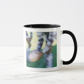 Close up of a Rugby Union Player Passing The Mug