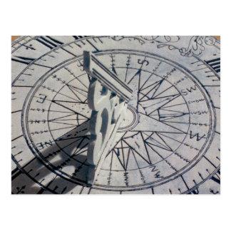 Close-up of a sundial postcard
