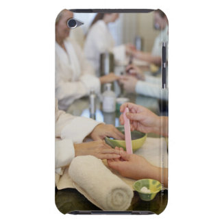Close-up of a woman's hand getting a manicure iPod Case-Mate case