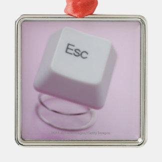 Close-up of an escape key Silver-Colored square ornament