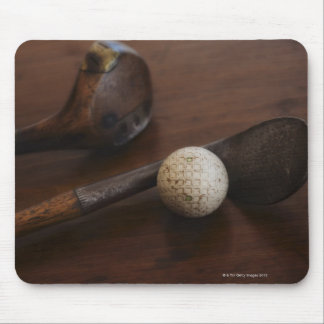 Close up of antique golf clubs and golf ball mouse pad