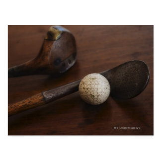 Close up of antique golf clubs and golf ball postcard