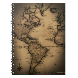 Close up of antique world map notebooks