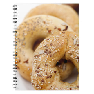 Close-up of assorted bagels on a plate notebook