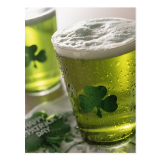 Close up of beverages with shamrocks on glass postcard