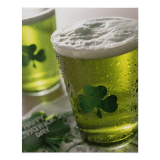 Close up of beverages with shamrocks on glass poster