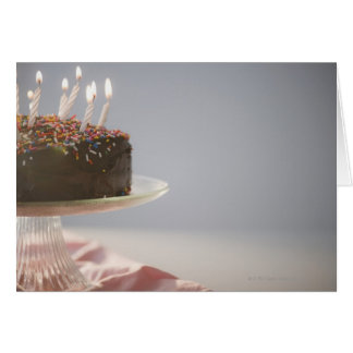 Close up of chocolate birthday cake with candles card