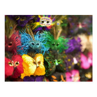 Close-up of colorful miniature masks in a New Postcard