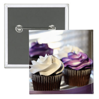 Close-up of cupcakes with selective focus on 2 inch square button