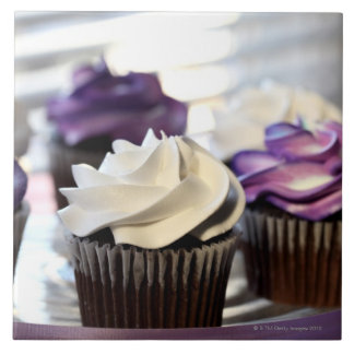 Close-up of cupcakes with selective focus on ceramic tiles
