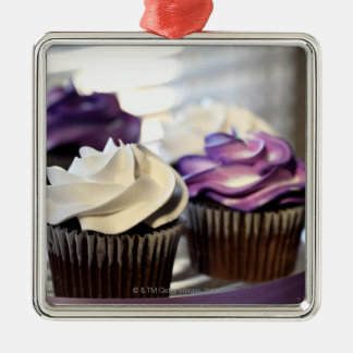 Close-up of cupcakes with selective focus on Silver-Colored square ornament