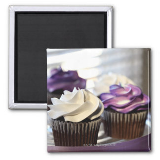 Close-up of cupcakes with selective focus on square magnet