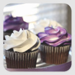 Close-up of cupcakes with selective focus on square sticker