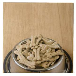 Close-up of dog biscuits in a dog bowl ceramic tile