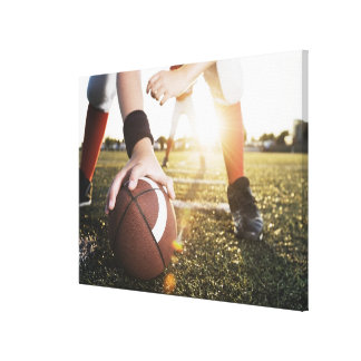 Close up of football center preparing to snap canvas print