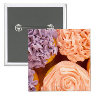 Close-up of frosted cupcakes 2 inch square button