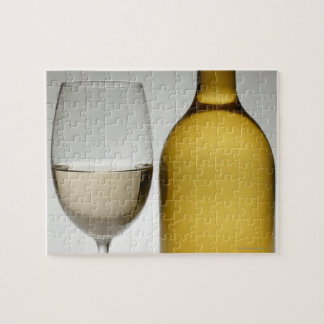 Close up of glass of white wine and wine bottle jigsaw puzzle