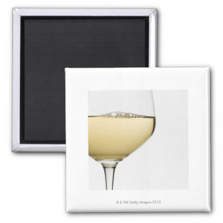 Close up of glass of white wine on white magnet