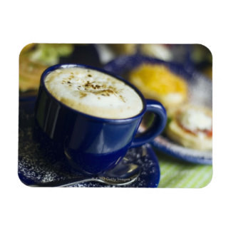 Close-up of latte on table rectangular photo magnet